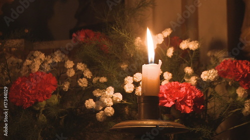 Candle decoration with bouquet of flowers