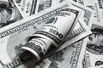One hundred dollar banknotes background with roll