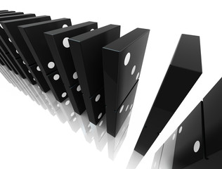 An isolated black domino blocks chain reaction on white backgrou
