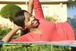 woman reclining on grass