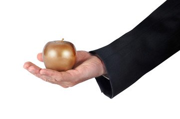 Hand with golden apple