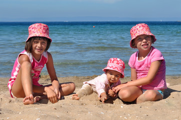 Three girls playing on the beach
