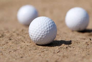 three golfballs On sand