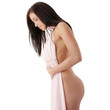 Beautiful nude woman trying pink dress