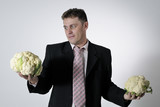 man evaluating cauliflower poster