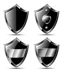 Set of four black steel triangle shields - isolated on white