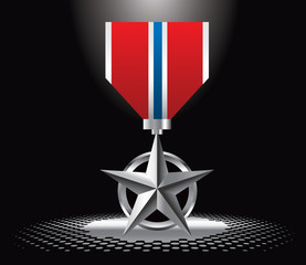 Military medal under spotlight