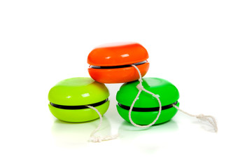 Green and red yoyos on a white background