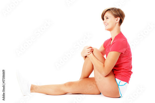 Young Fitness Woman in Red Shirt Stretching, Isolated on White