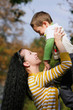 happy mother and son outdoors portrait