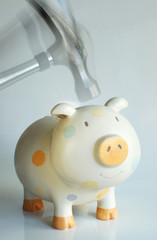 Hammering the piggy bank in action