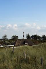 Haus und Leuchtturm