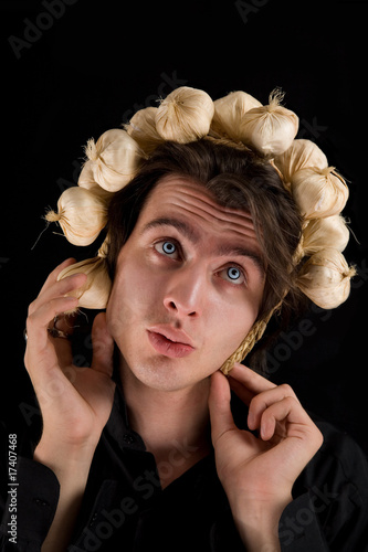 Funny shot of vampire with garlic on his head