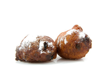 two Dutch donut oliebollen over white background