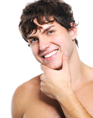 Face of a happy young man with health  clean skin
