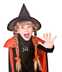 Child girl in costume Halloween witch  with hand stop.