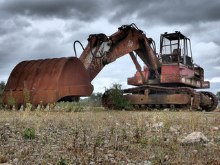 360 digger rusty in a field