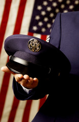 Military personnel holding hat