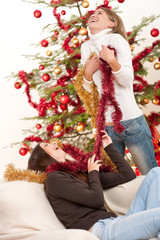 Two young woman having fun with Christmas decoration