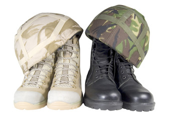 two pairs of combat boots and helmets on white background