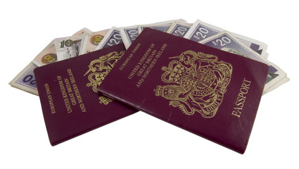 british passports with twenty and ten pound notes