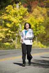 Woman in fall running