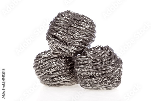 Three stainless steel scouring pads isolated on a white