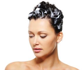 Female hairs wiht a shampoo on it