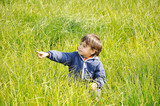 Happy childhood on green beautiful meadow poster