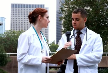 Doctors downtown outside discuss lab results