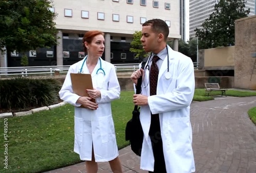City doctors outside walking and talking
