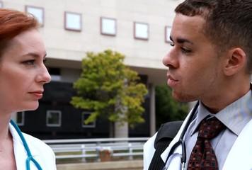 Two doctors downtown outside talking