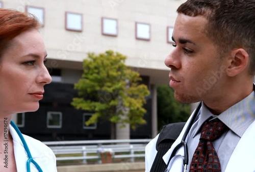 Two doctors downtown outside talking