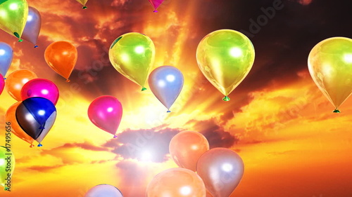 Colorful balloons flying and sunset time lapse clouds