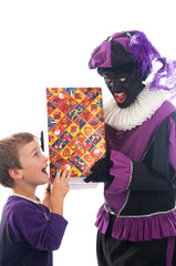 Zwarte Piet giving a child his present