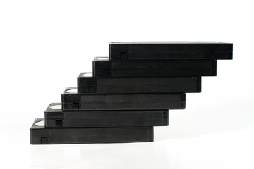 """Staircase"" of old video tapes (on a white background)"