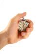 Leinwandbild Motiv Male hand with stopwatch