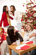 Four young women having fun on Christmas
