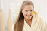 Young woman in bathrobe poster