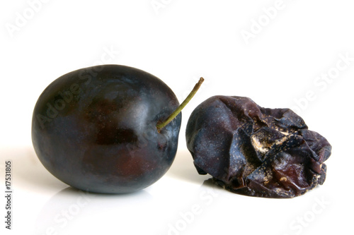 Fresh plum and rotten plum