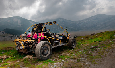 4wd buggy for extreme off-road shot on mountain