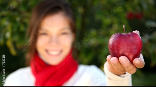 Woman showing red apple