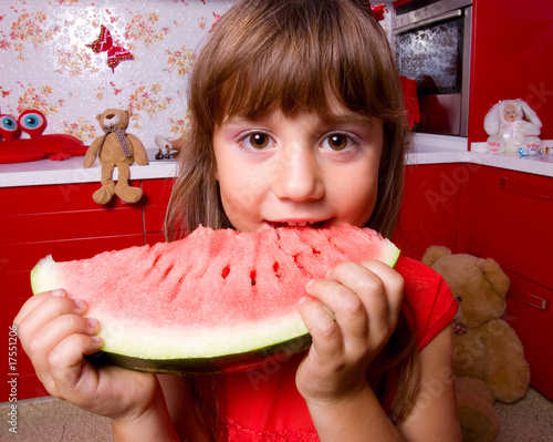 The girl winh a watermelon