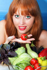 The red girl holds a tomato