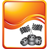 Racing tires and flags on orange wave background