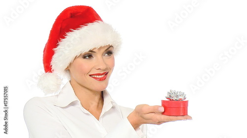 Sexy girl in santa claus hat showing a gift in box