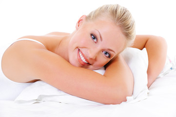Happy woman embrace the white pillow