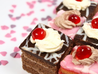 Delicious cakes with chocolate and sweet hearts