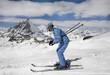 Young woman ski down a mountain slope