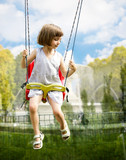 Little girl on a swing